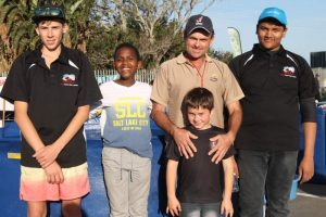 IN THE SWIM: Some of the competitors in the South African Koi Keepers Society Eastern Cape Chapter Spargs Superspar Koi Show are, from left, Stefan de Lange, Soso Flanegan, Leon Krull, Dylan Krull (in front) and Simon Jeebun. Leon Krull won the supreme grand champion and reserve grand champion awards Picture: SARAH KINGON