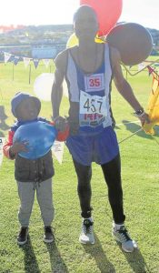 PROUD PAIR: Mcebisi Yose and son, Mabufike, celebrate after Mcebisi won the 40th Washie 100 Miler run from Port Alfred to East London at the weekend. Mcebisi, who on three previous occasions, came in second, kept his cool to win his first Washie Pictures: ETHIENNE ARENDS