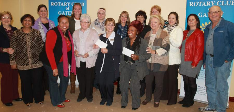 ON TOP OF THE WORLD: Rotary Anns stand with their nine chosen organisations at a Regent Hotel function in East London after handing over to them R64000 which was raised through the 'Sittin' on Top of the World concert featuring Broadway star Amra-Faye Wright, earlier this year Picture:  SARAH   KINGON