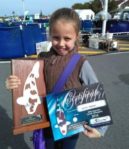 GOOD CATCH: Young competitor Kayla Jordan, 7, from Grens Primary showed off her girl power at the Spargs Superspar Koi Show over the weekend, walking away with the title of the kids supreme grand champion Picture: SUPPLIED