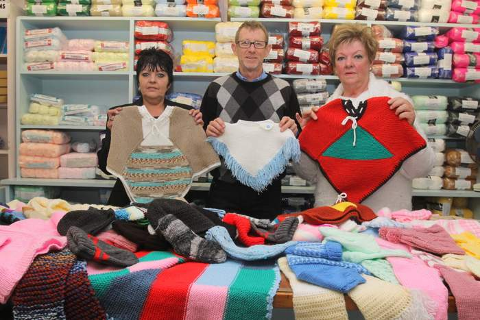 KNITTERS UNITE: Head of Kingons wool department Geraldine Odendaal, owner of Kingons Mark Kingon and Mizpah Kretzmann are seen with some of the wool garment donations made by the public as part of the clothing store's knit -a-thon Picture: SARAH KINGON