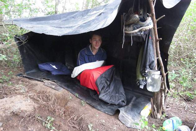 THREADBARE SHELTER: Preparing for  Lilyfontein 's  SleepOut  tonight, pupil Simone Courtois tucks in after building his own shelter and spending 48 hours without food or electronics