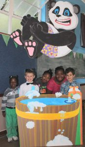 GETTING TO KNOW JESUS: Owen Otieno, Etienne Fourie, Zenande Mpepo, Lathi Gxolo and Liam van der Merwe stand beside the panda artwork displayed at the Cambridge Baptist Church holiday club last year. The week featured a fun-filled programme for children, where they learnt about Jesus and how He cares about them. Picture: SARAH KINGON