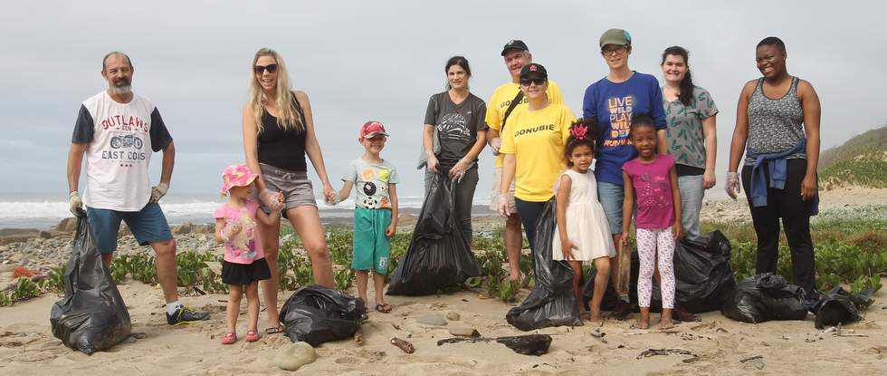 GONUBIE GO-GETTERS: Gonubie Harriers and community members clean up the Eastward Ho side of Gonubie Beach on Saturday, ahead of the Coastal Challenge hosted by Gonubie Running Club on November 12 Picture: SARAH KINGON