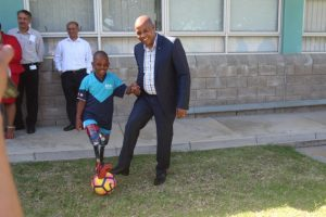 BEAUTIFUL GAME: Young Ubuko Mpotulo can finally run and kick a soccer ball after he received new sports prosthetic legs last week. He had a bit of a kick-about with Eastern Cape Premier Phumulo Masualle at the event where Paralympic medal winner Ernst van Dyk handed over the legs Picture: QHAMANI LINGANI