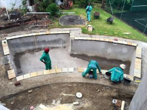 PUMP SCAM: Pacific Pools workers build one of their award- winning swimming pools. The company, like others, were recently almost scammed out of tens of thousands of rands.