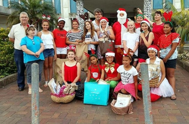 SANTA'S HELPERS: Hudson Port Rex Lions Clubs dressed up as Santa's helpers to spread Christmas cheer at the Frere Hospital children's wards. They delivered Christmas lucky packets, cooldrinks, toiletries and sweets.