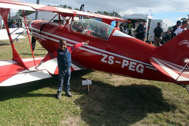 LOFTY IDEALS: Bungcwalisa Koni, 5, is an airplane fanatic, so being at the Airfest during the weekend was like a dream come true for the youngster Picture: ETHIENNE ARENDS